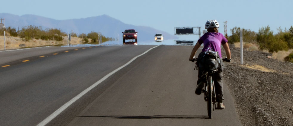reflection-on-the-road-in-nevada-riding-a-bicycle